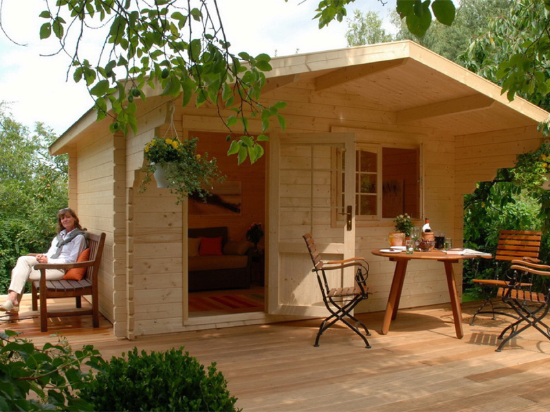 Small log cabin kits like this 113 sqft Allwood Kit Cabin Lillevilla Escape offer an affordable retreat.