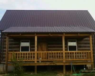 Antique looking concrete log cabin for Concrete log cabins