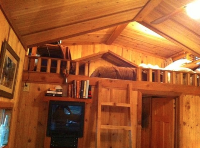 Cabin loft with ladder stairs.