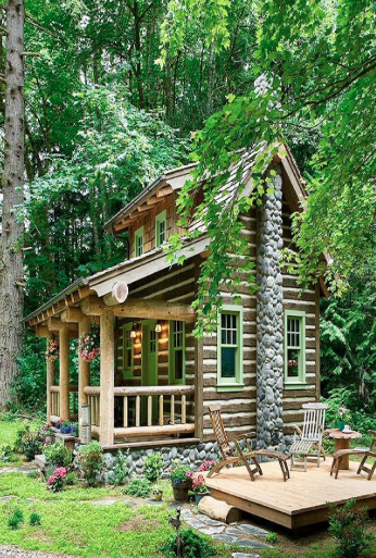 The Small Cabin Lifestyle - a classic woodie tucked into the forest.