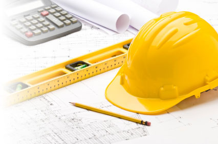Blueprints, hard hat, level and calculator.