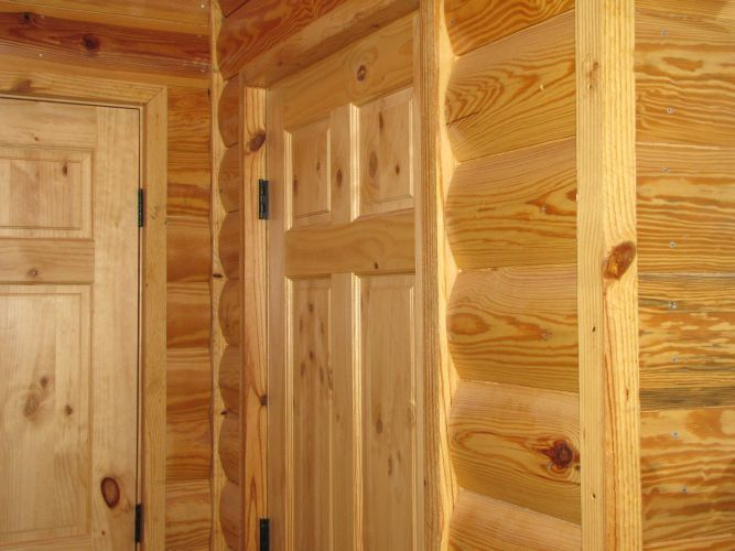Log siding used on an interior wall.