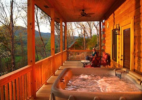 Rental cabin with hot tub on deck.