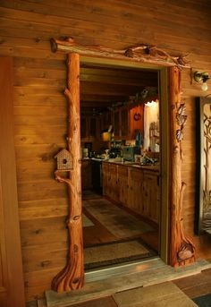 Log accents surround interior doorway.