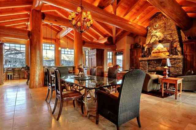 Interior of log home great room shows log cabin decor ideas.