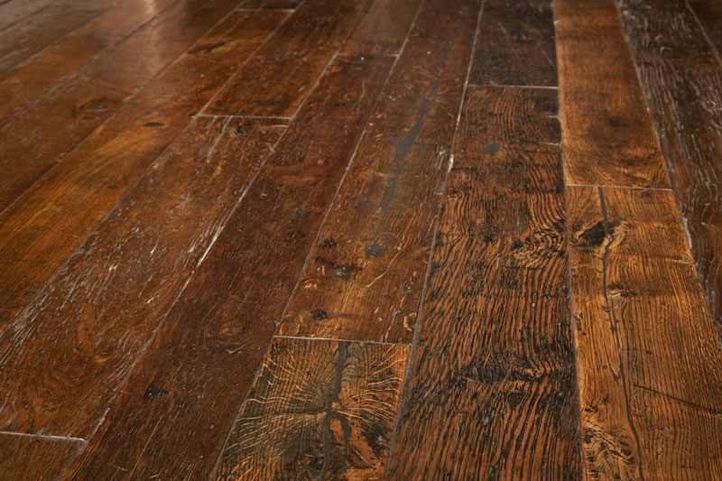 Reclaimed wood flooring from log cabin suppliers.
