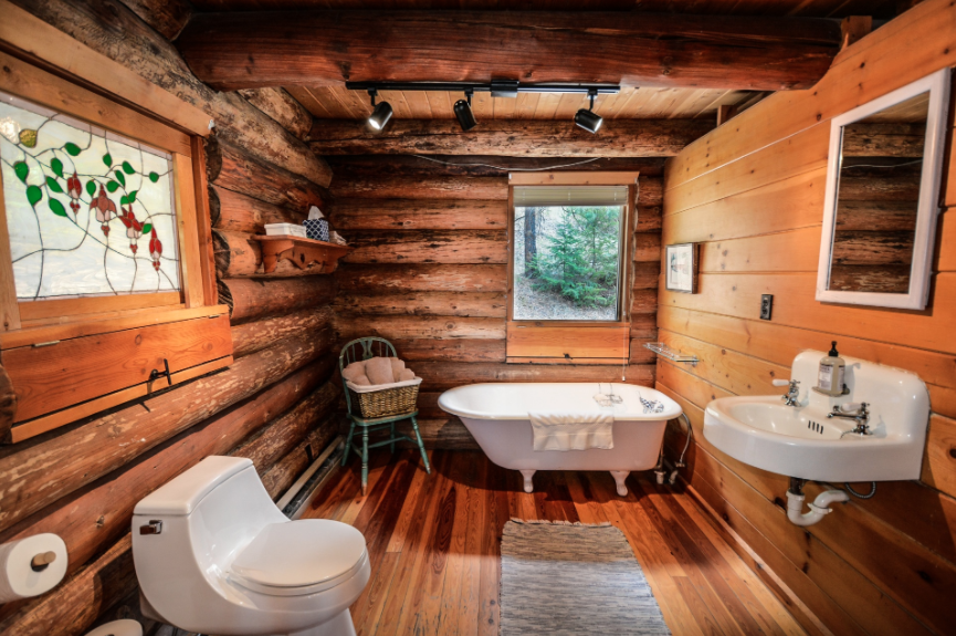 Cabin bathroom in log home.