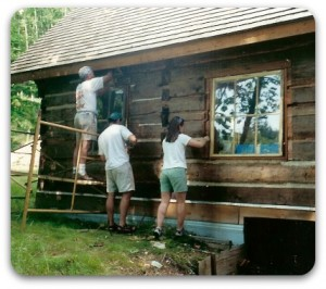 Staining the exterior log walls.
