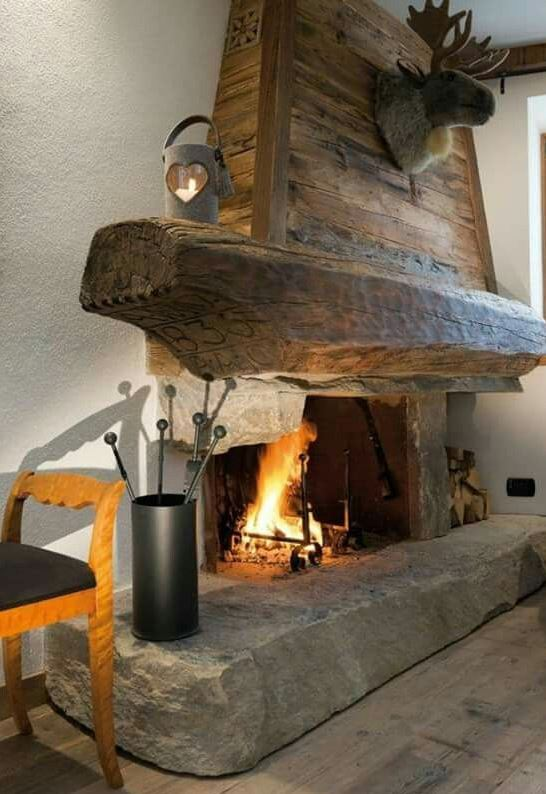 Rustic timber fireplace mantel.