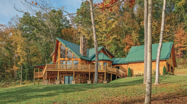 Sloping property with log home.