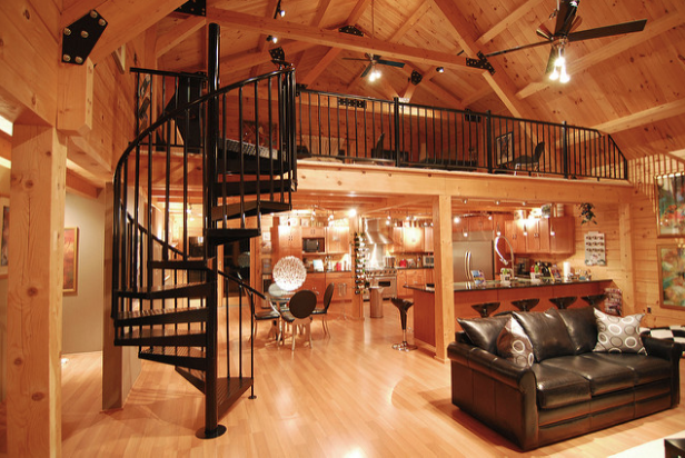 Cabin loft with spiral stairs.