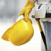 Subcontractors hardhat and tool belt.